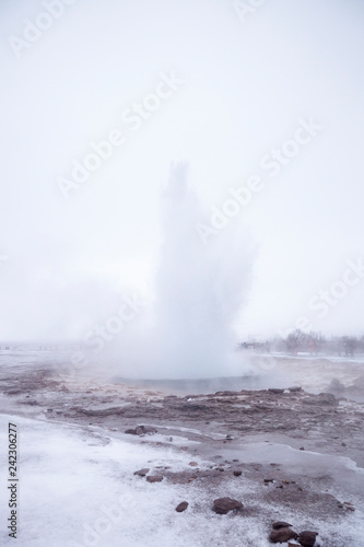 Leinwandbild Motiv Eruption Of Steam And Water From Geothermal Pool In Iceland