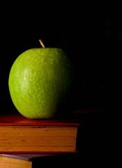 alone green apple with shadow on the old book © sema_srinouljan