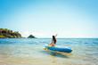 Leinwandbild Motiv Frau paddelt in ihrem Kajak auf dem Meer im klaren Wasser