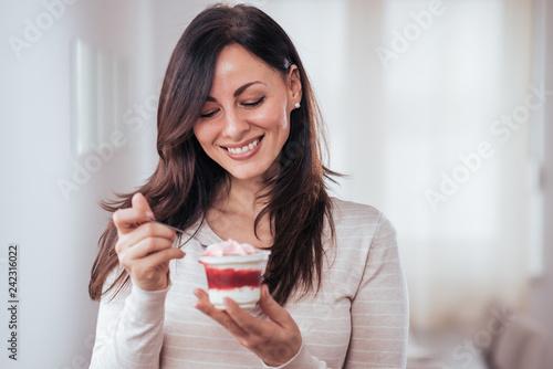 Leinwandbild Motiv Beautiful woman with creamy dessert.