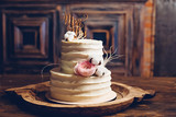 Rustic style wedding cake with cotton and floral decoration. - 242320809