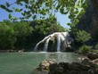 Wide shot of Turner Falls framed by tree leaves, Arbuckle Mountains, Oklahoma - 242323201