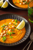creamy carrot chickpea soup on dark rustic background - 242331476