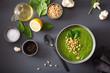 Leinwandbild Motiv green creamy cauliflower spinach soup on gray background