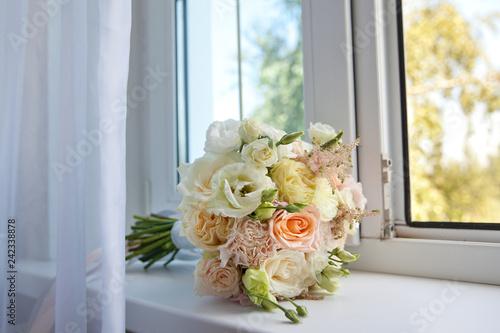 Beautiful bouquet of flowers on the windowsill.