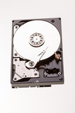 Open computer hard drive disc on white - 242339494