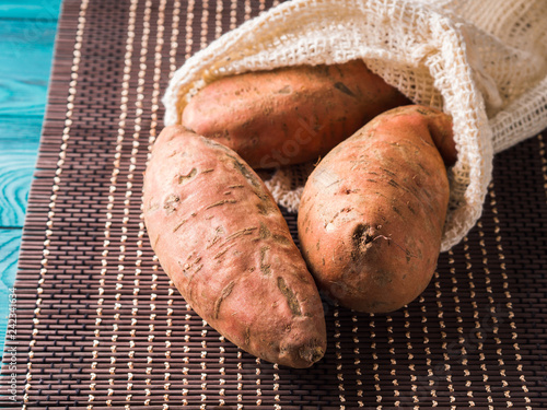 Foto Murales Sweet potato tubers in a reusable cotton bag
