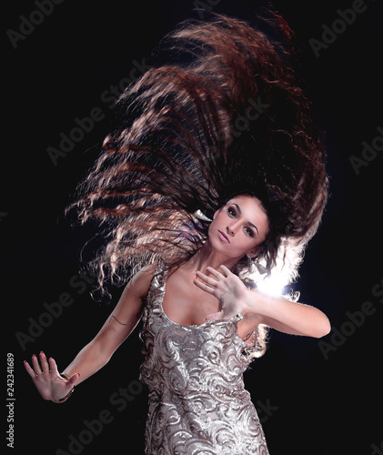 Portrait of a young girl dancing with long dark hair - 242341689