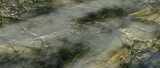 Aerial of landscape of cracked rocks with green moss. - 242344493