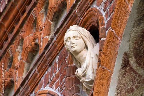 Milano, Università Statale, fregi della facciata