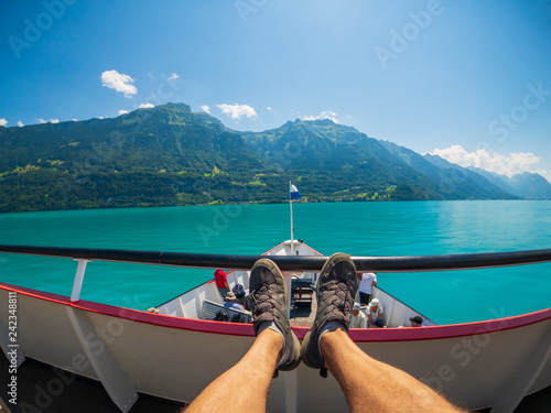 POV travelling by boat at Brienz lake at summer time in Switzerland. - 242348811