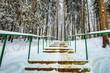 Leinwanddruck Bild - Staircase with railings in snowy park.