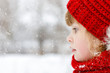 A small child is looking at the snowflakes. - 242354063