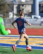 Leinwanddruck Bild - Young girls making amazing plays during a soccer match