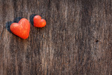 two hearts on old wooden background - 242358044