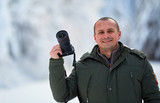 Man with camera outdoor in the snow - 242358886