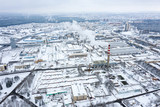 aerial view of the snow-covered industrial area of the city. winter season - 242400822