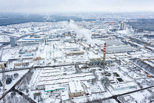 aerial view of the snow-covered industrial area of the city. winter season