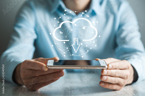 Foto Murales Man touching a cloud networking hand phone