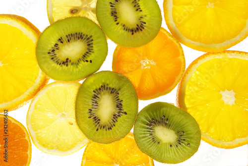Oranges, citrons, kiwi, apples. Cut.Isolated on white