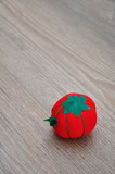 A pin cushion shaped as a red tomato - 242414667