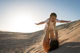 Having fun on sand dunes - 242415478
