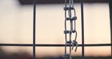 Chains on a fence (4K) - 242416260