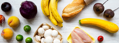 Set of various organic food on white wooden background, overhead view. Cooking food background. Health food concept.