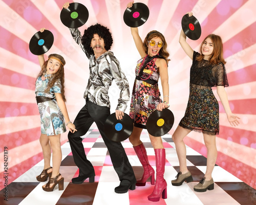 Family dressed in disco style with vinyl records - 242427879