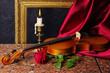 Leinwanddruck Bild - Violin, red rose, burning candle, drapery