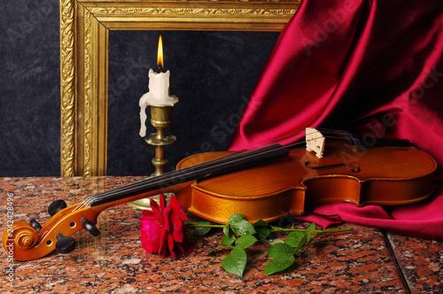 Leinwanddruck Bild Violin, red rose, burning candle, drapery