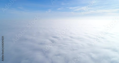 Aerial view, flying over clouds of fog.
