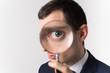 Leinwanddruck Bild - 虫眼鏡で見る男性