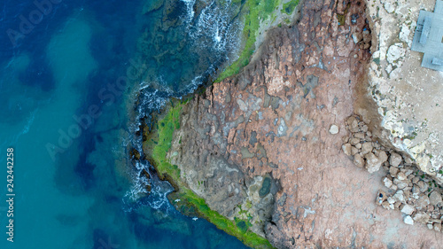 roks and sea showed from drone blue sea air photo