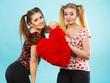 Quadro Happy two women holding heart shaped pillow