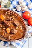 Beef Bourguignon stew in a casserole dish - 242453616