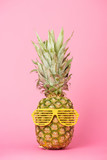 funny and tasty pineapple in sunglasses on pink background - 242454498