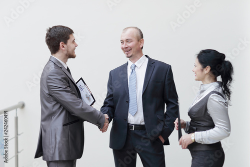 close up.businessman handshake with business woman. concept of cooperation