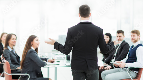 Poster  CEO speaks at the workshop business team in a modern office