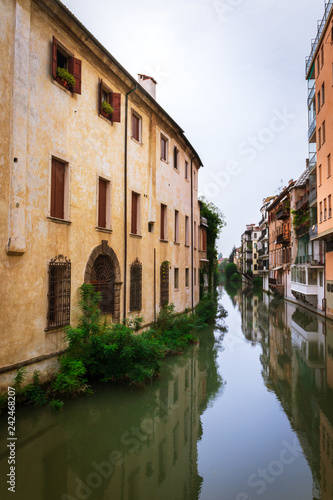 View of canal lined by houses in Padova (Padua), Italy - 242468207