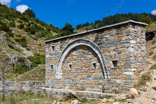 Traditional stone drinking fountain in the village of Kokkinopilos on Mount Olympus in Thessaly , Greece