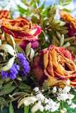 Close-up of a bouquet of dried roses and various complementary plants. Focussed is the rose on the right side. - 242475848