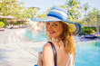 Woman walking by swimming pools on vacation in luxury resort