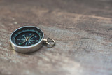 compass on a wooden background - travel concept - 242489649