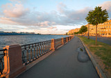 Makarova embankment, in the evening at sunset in the direction of the exchange bridge. Saint-Petersburg - 242491478