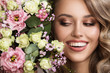 Leinwanddruck Bild - Close up portrait of beautiful smiling woman. Flowers near her face.