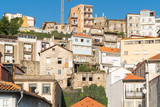 Typical old townhouses of Portuguese architectural style in the hillside of the Miragaia district of Porto - 242495862