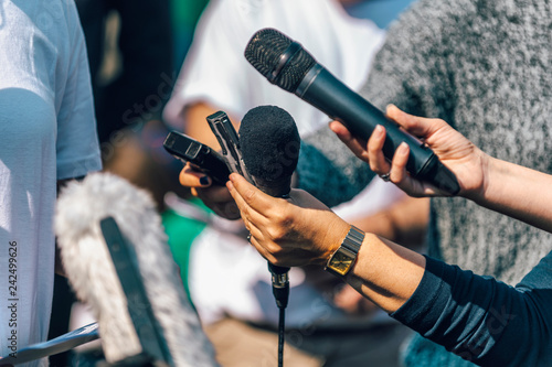 Journalists Interviewing. Female Speaker Answering Questions