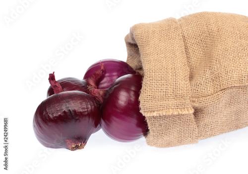 fresh of purple onion in burlap sack isolated on white background