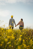 Loving couple in meadow admiring the view - 242506645